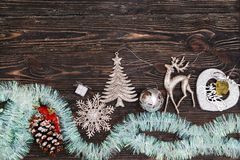 Christmas decoration on dark wooden board. Top view royalty free stock image