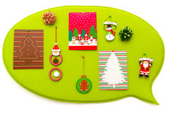 Christmas decoration. A decorative board hung on a white wall decorated with christmas cards and christmas ornaments Stock Photography
