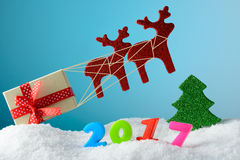 Christmas decoration deer carry a gift box Stock Photography