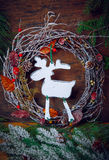 Christmas decoration. Deer silhouette of a Christmas wreath. Dark background. Royalty Free Stock Photo