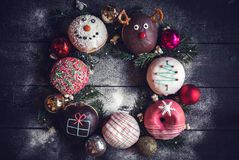 Christmas decoration on donuts Stock Photography