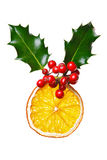 Christmas decoration with dried orange and holly. Royalty Free Stock Images