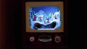 Christmas decoration. An entire village in a small antique TV, with the train and people on the streets stock footage