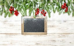 Christmas decoration Evergreen tree red berries chalkboard Stock Photography
