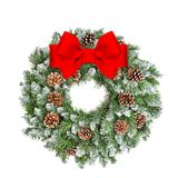 Christmas decoration evergreen wreath cones red ribbon bow. Christmas decoration evergreen wreath with cones and red ribbon bow isolated on white background Stock Photos