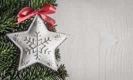 Christmas decoration, evergreens, white wood, Royalty Free Stock Image