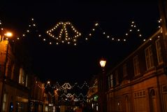 Christmas decoration. Fairy lights and street lamps at night Stock Image
