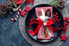 Christmas decoration. Festive plate and cutlery with Christmas decoration. Christmas background Stock Photo