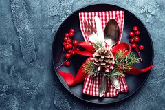 Christmas decoration. Festive plate and cutlery with Christmas decoration. Christmas background Royalty Free Stock Photos