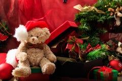 Christmas balls, teddy bear and gifts stock image