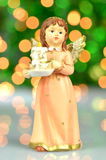Christmas decoration, figure of angel holding a candle Royalty Free Stock Photo