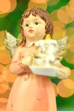 Christmas decoration, figure of angel holding a candle Royalty Free Stock Photos