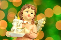 Christmas decoration, figure of angel holding a candle Stock Image