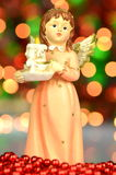 Christmas decoration, figure of angel holding a candle royalty free stock images