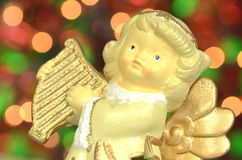 Christmas decoration, figure of angel playing the harp Royalty Free Stock Photography