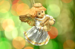 Christmas decoration, figure of little angel playing the harp Stock Image