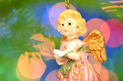 Christmas decoration, figure of little angel singing carols Stock Image