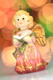 Christmas decoration, figure of little angel singing carols Royalty Free Stock Photo