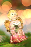 Christmas decoration, figure of little angel singing carols Stock Photos