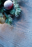 Christmas decoration with fir and baubles. Royalty Free Stock Photos