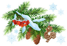 Christmas decoration. Fir branch, gingerbread rooster and rowan berries under snow Royalty Free Stock Images