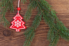 Christmas decoration with fir branch over wooden background Stock Photos