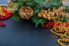 Christmas decoration, fir branch, pine cones, tinsel. Stock Images