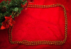 Christmas decoration fir branch on red Royalty Free Stock Images