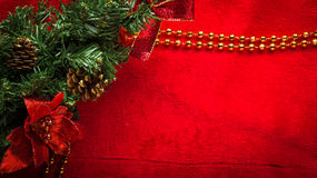 Christmas decoration fir branch on red Stock Photography