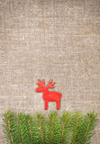 Christmas decoration with fir branch and red deer on burlap Stock Photo