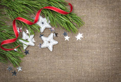 Christmas decoration with fir branch and stars Stock Photos