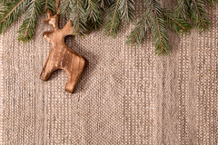 Christmas decoration with fir branch and wooden deer above Royalty Free Stock Photo