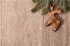 Christmas decoration with fir branch and wooden deer at top righ Stock Image