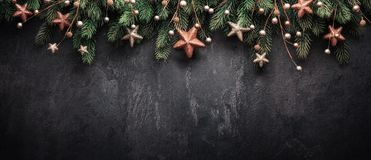 Christmas Decoration With fir Branches on a Dark Shale Backgroun Royalty Free Stock Images