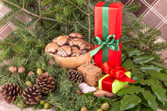 Christmas decoration with fir branches, mistletoe, wood cookies and gifts Stock Image