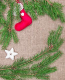 Christmas decoration with fir branches and red sock on burlap Stock Photo