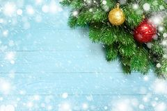 Christmas decoration with fir branches, snowflake on blue board wooden background royalty free stock photos