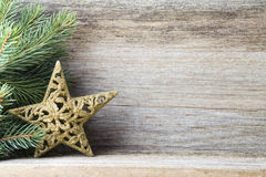 Christmas decoration with fir branches on the wood background. Stock Photos