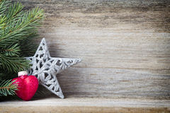 Christmas decoration with fir branches on the wood background. Royalty Free Stock Photo