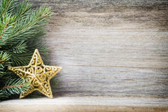 Christmas decoration with fir branches on the wood background. Stock Images