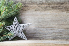 Christmas decoration with fir branches on the wood background. Stock Image