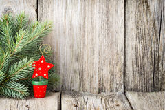 Christmas decoration with fir branches on the wood background. Stock Photography