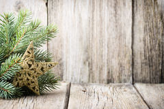 Christmas decoration with fir branches on the wood background. Royalty Free Stock Photography