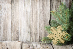 Christmas decoration with fir branches on the wood background. Stock Photo