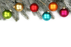 Christmas decoration fir tree balls baubles snow winter isolated. On a white background Royalty Free Stock Images