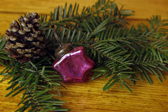 Christmas decoration- fir tree, bauble and cone Stock Photos