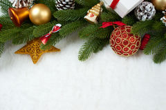 Christmas decoration on fir tree branch closeup, gifts, xmas ball, cone and other object on white blank space fur, holiday concept Stock Photos