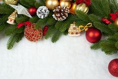 Christmas decoration on fir tree branch closeup, gifts, xmas ball, cone and other object on white blank space fur, holiday concept Stock Photography