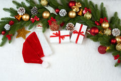 Christmas decoration on fir tree branch closeup, gifts, xmas ball, cone and other object on white blank space fur, holiday concept Stock Images