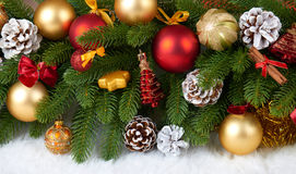Christmas decoration on fir tree branch closeup, gifts, xmas ball, cone and other object on white blank space fur, holiday concept Stock Photo